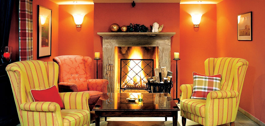 Sporthotel Austria, St. Johann, Austria - Lounge with open fireplace.jpg